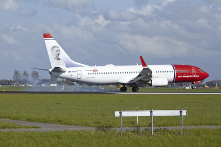 livery: A Boeing 737-8JP of Norwegian (Anders Zorn livery) lands at Amsterdam Airport Schiphol (The Netherlands, AMS) on May 7, 2015. The name of the runway is Polderbaan.