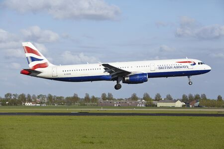 airways: An Airbus A321-231 of British Airways lands at Amsterdam Airport Schiphol (The Netherlands, AMS) on May 7, 2015. The name of the runway is Polderbaan.