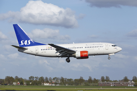 jetliner: A Boeing 737-705 of SAS (Scandinavian Airlines) lands at Amsterdam Airport Schiphol (The Netherlands, AMS) on May 7, 2015. The name of the runway is Polderbaan.