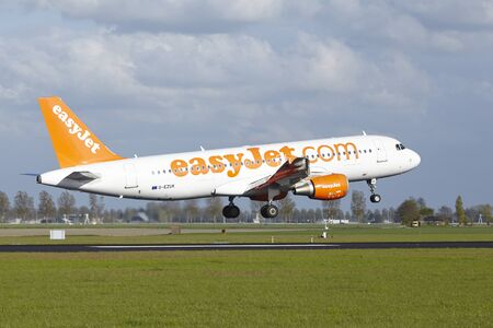 schiphol: An Airbus A320-214 of EasyJet lands at Amsterdam Airport Schiphol (The Netherlands, AMS) on May 7, 2015. The name of the runway is Polderbaan.