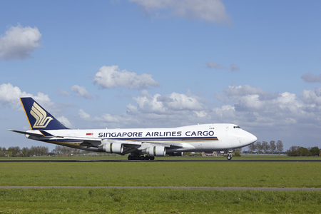 jetliner: A Boeing 747-412F (SCD) of Singapore Airlines Cargo lands at Amsterdam Airport Schiphol (The Netherlands, AMS) on May 7, 2015. The name of the runway is Polderbaan. Editorial