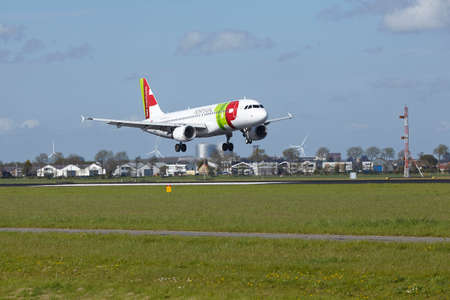 polderbaan: An Airbus A320-214 of TAP Portugal lands at Amsterdam Airport Schiphol (The Netherlands, AMS) on May 7, 2015. The name of the runway is Polderbaan. Editorial