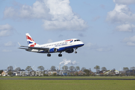schiphol: An Embraer ERJ-170 of British Airways CityFlyer lands at Amsterdam Airport Schiphol (The Netherlands, AMS) on May 7, 2015. The name of the runway is Polderbaan. Editorial