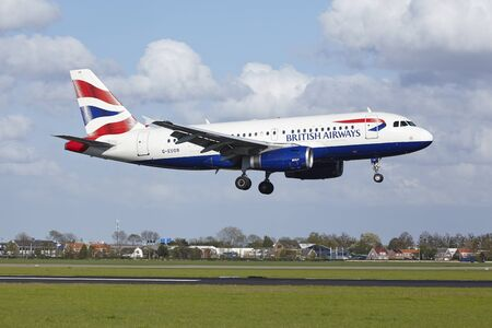 polderbaan: An Airbus A319-131 of British Airways lands at Amsterdam Airport Schiphol (The Netherlands, AMS) on May 7, 2015. The name of the runway is Polderbaan. Editorial
