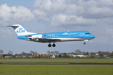 polderbaan: A Fokker 70 of KLM Cityhopper lands at Amsterdam Airport Schiphol (The Netherlands, AMS) on May 7, 2015. The name of the runway is Polderbaan.