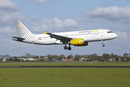 polderbaan: An Airbus A320-232 of Vueling lands at Amsterdam Airport Schiphol (The Netherlands, AMS) on May 7, 2015. The name of the runway is Polderbaan.