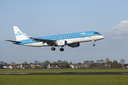 klm: An Embraer ERJ-190 of KLM Cityhopper lands at Amsterdam Airport Schiphol (The Netherlands, AMS) on May 7, 2015. The name of the runway is Polderbaan.