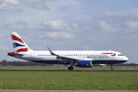 airways: An Airbus A320-232 of British Airways lands at Amsterdam Airport Schiphol (The Netherlands, AMS) on May 4, 2015. The name of the runway is Polderbaan. Editorial