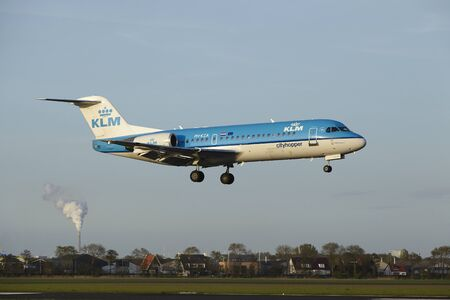 klm: A Fokker 70 of KLM Cityhopper lands at Amsterdam Airport Schiphol (The Netherlands, AMS) on May 7, 2015. The name of the runway is Polderbaan.