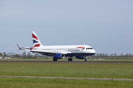 polderbaan: An Airbus A320-232 of British Airways lands at Amsterdam Airport Schiphol (The Netherlands, AMS) on May 4, 2015. The name of the runway is Polderbaan. Editorial