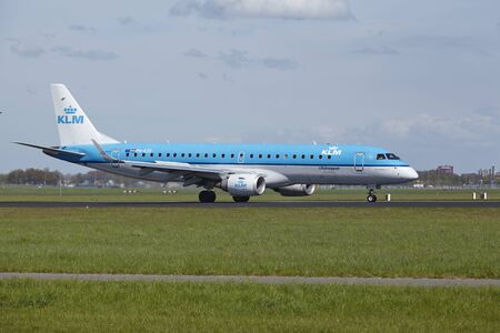 klm: An Embraer ERJ-190 of KLM Cityhopper lands at Amsterdam Airport Schiphol (The Netherlands, AMS) on May 4, 2015. The name of the runway is Polderbaan.