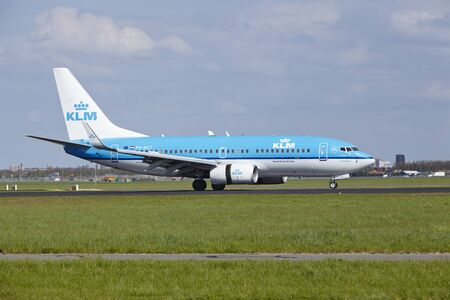 A Boeing 737-7K2 of KLM lands at Amsterdam Airport Schiphol (The Netherlands, AMS) on May 4, 2015. The name of the runway is Polderbaan. Editorial