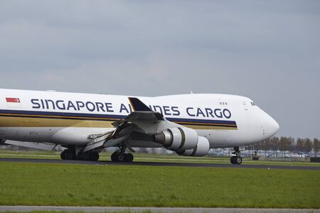 A Boeing 747-412F (SCD) of Singapore Airlines Cargo lands at Amsterdam Airport Schiphol (The Netherlands, AMS) on May 4, 2015. The name of the runway is Polderbaan. Editorial