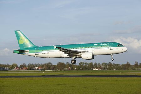 An Airbus A320-214 of Aer Lingus lands at Amsterdam Airport Schiphol (The Netherlands, AMS) on May 7, 2015. The name of the runway is Polderbaan.