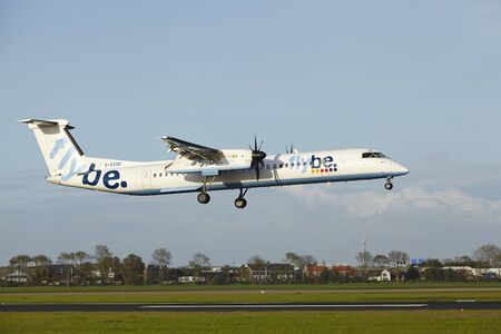 polderbaan: A Bombardier Dash 8 Q400 of Flybe lands at Amsterdam Airport Schiphol (The Netherlands, AMS) on May 7, 2015. The name of the runway is Polderbaan.