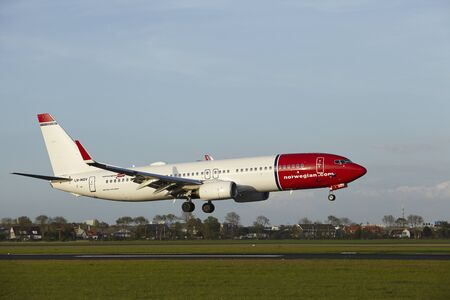 A Boeing 737-8JP of Norwegian lands at Amsterdam Airport Schiphol (The Netherlands, AMS) on May 7, 2015. The name of the runway is Polderbaan.