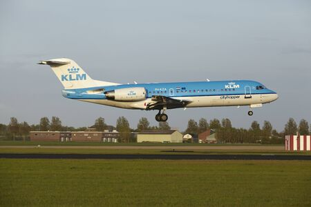 schiphol: A Fokker 70 of KLM Cityhopper lands at Amsterdam Airport Schiphol (The Netherlands, AMS) on May 7, 2015. The name of the runway is Polderbaan.