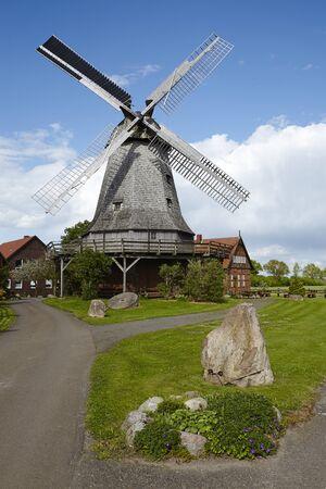 historically: The windmill Messlingen (Petershagen, Germany) is a dutch-type mill and part of the Westphalia Mill Street (Westfaelische Muehlenstrasse) in the rural district Minden-Luebbecke. Stock Photo
