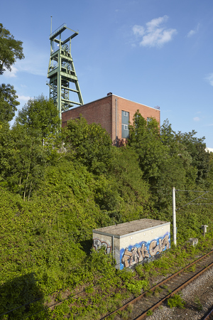 heinrich: The coal mine Heinrich near the interurban train station (S-Bahn) Essen-Holthausen (Germany, Northrhine Westphalia) taken at bright sunshine on July 31, 2015.