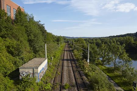 railroad tracks: Railroad tracks near the interurban train station (S-Bahn) Essen-Holthausen (Germany, Northrhine-Westphalia) taken at sunlight on July 31, 2015. Editorial
