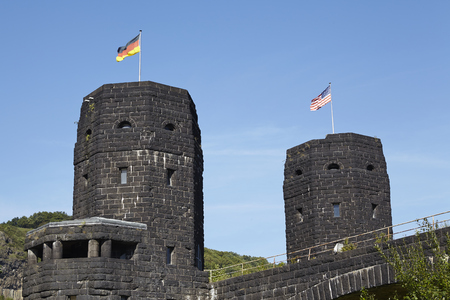 aliados: The flags of the Allies and Germany blow on the both towers of The Remagen Bridge (Germany, Rhineland-Palatinate, administrative district Ahrweiler) which was destroyed at the second world war.