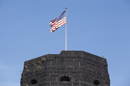 aliados: The flag of the Allies blows on the tower of The Remagen Bridge (Germany, Rhineland-Palatinate, administrative district Ahrweiler) which was destroyed at the second world war.