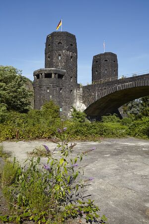 seconda guerra mondiale: A piece of old roadway is located behind The Remagen Bridge (Germany, Rhineland-Palatinate, administrative district Ahrweiler) which was destroyed at the second world war. Editoriali