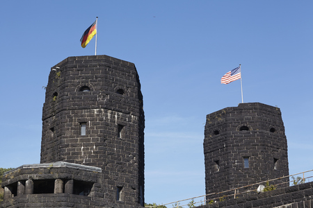 seconda guerra mondiale: The flags of the Allies and Germany blow on the both towers of The Remagen Bridge (Germany, Rhineland-Palatinate, administrative district Ahrweiler) which was destroyed at the second world war.