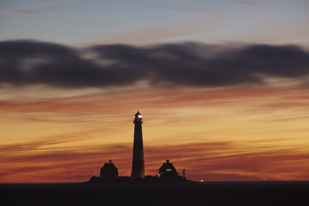 schleswig holstein: The lighthouse Westerhever (Germany, Schleswig Holstein, North Frisia) photographed in the evening after sunset. Stock Photo