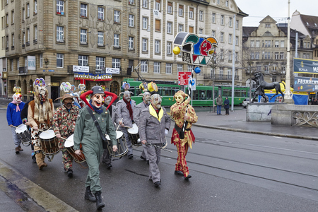 clique: A carnival clique walks fully costumed through the streets on the morning of the Carnivel at Basel 2016 (Basle - Switzerland) on February 15, 2016.