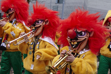 vernacular: Some fully costumed carnival activists walk through the city during the carnival procession (cortege) of the Carnivel at Basel 2016 (Basle - Switzerland) on February 15, 2016.