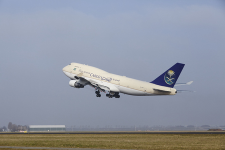 airborn: A Boeing 747-412(BDSF) of Saudia Cargo takes off at Amsterdam Airport Schiphol (The Netherlands, AMS) on March 11, 2016. The name of the runway is Polderbaan. Editorial