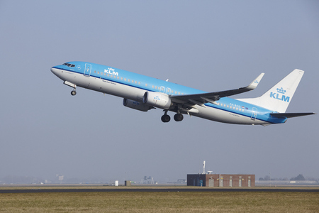 airborn: A Boeing 737-8K2 of KLM takes off at Amsterdam Airport Schiphol (The Netherlands, AMS) on March 11, 2016. The name of the runway is Polderbaan. Editorial