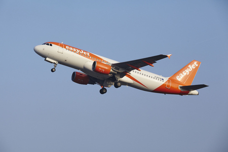 airborn: An Airbus A320-214 of EasyJet takes off at Amsterdam Airport Schiphol (The Netherlands, AMS) on March 11, 2016.  The plane is already high in the air. Editorial