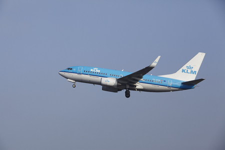 airborn: A Boeing 737-7K2 of KLM takes off at Amsterdam Airport Schiphol (The Netherlands, AMS) on March 11, 2016.  The plane is already high in the air.