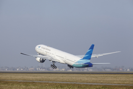 airborn: A Boeing 777-3U3(ER) of Garuda Indonesia takes off at Amsterdam Airport Schiphol (The Netherlands, AMS) on March 11, 2016. The name of the runway is Polderbaan. Editorial