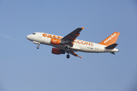 airborn: An Airbus A319-111 of EasyJet takes off at Amsterdam Airport Schiphol (The Netherlands, AMS) on March 11, 2016. The plane is already high in the air. Editorial