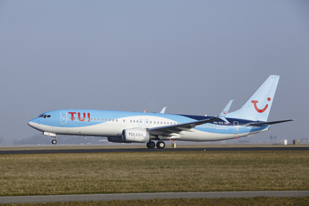 A Boeing 737-86N of TUI Airlines Netherlands takes off at Amsterdam Airport Schiphol (The Netherlands, AMS) on March 11, 2016. The name of the runway is Polderbaan.