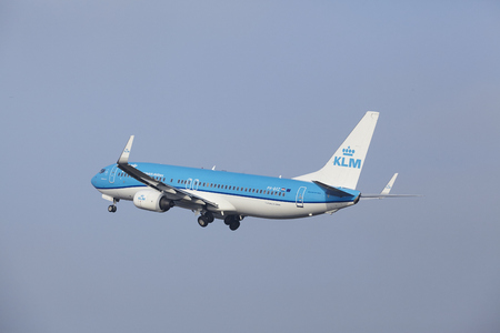 airborn: A Boeing 737-8K2 of KLM takes off at Amsterdam Airport Schiphol (The Netherlands, AMS) on March 11, 2016. The plane is already high in the air.