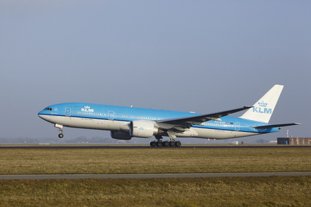 polderbaan: A Boeing 777-206(ER) of KLM takes off at Amsterdam Airport Schiphol (The Netherlands, AMS) on March 11, 2016. The name of the runway is Polderbaan. Editorial
