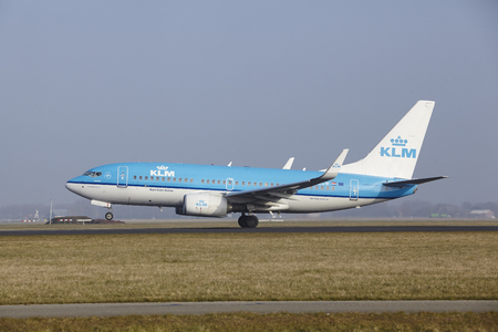 polderbaan: A Boeing 737-7K2 of KLM takes off at Amsterdam Airport Schiphol (The Netherlands, AMS) on March 11, 2016. The name of the runway is Polderbaan. Editorial