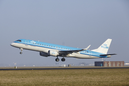 airborn: An Embraer ERJ-190STD of KLM Cityhopper takes off at Amsterdam Airport Schiphol (The Netherlands, AMS) on March 11, 2016. The name of the runway is Polderbaan.