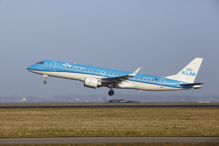 polderbaan: An Embraer ERJ-190STD of KLM Cityhopper takes off at Amsterdam Airport Schiphol (The Netherlands, AMS) on March 11, 2016. The name of the runway is Polderbaan.