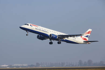 airborn: An Embraer ERJ-190SR of British Airways takes off at Amsterdam Airport Schiphol (The Netherlands, AMS) on March 11, 2016. The name of the runway is Polderbaan.
