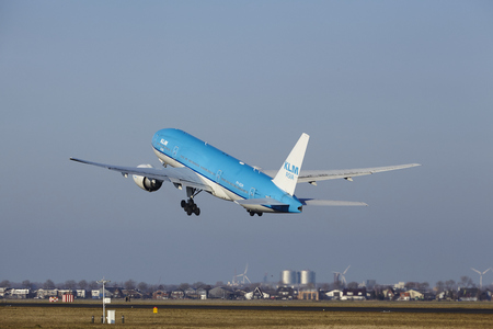 livery: The KLM Boeing 777-206(ER) (KLM Asia Livery) with identification PH-BQM takes off at Amsterdam Airport Schiphol (The Netherlands, AMS), Polderbaan on March 13, 2016.