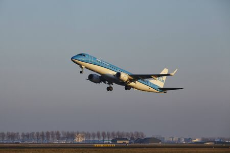 klm: The KLM Cityhopper Embraer ERJ-190STD with identification PH-EZI takes off at Amsterdam Airport Schiphol (The Netherlands, AMS), Polderbaan on March 13, 2016.