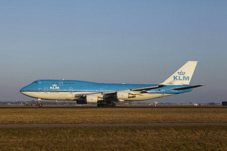 polderbaan: The KLM Boeing 747-406(M) with identification PH-BFK takes off at Amsterdam Airport Schiphol (The Netherlands, AMS), Polderbaan on March 13, 2016.