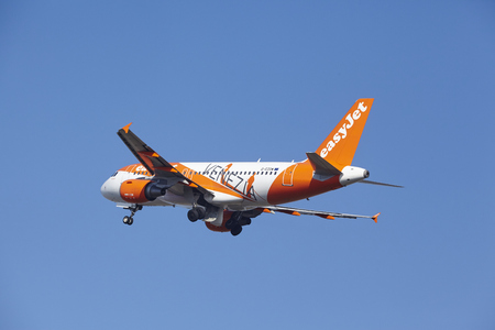 livery: The EasyJet Airbus A319-111 (Venezia Livery) with identification G-EZDW takes off at Amsterdam Airport Schiphol (The Netherlands, AMS), Polderbaan on March 13, 2016. The aircraft is already high in the air.