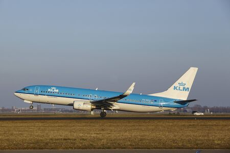 polderbaan: The KLM Boeing 737-8BK with identification PH-BXU takes off at Amsterdam Airport Schiphol (The Netherlands, AMS), Polderbaan on March 13, 2016.