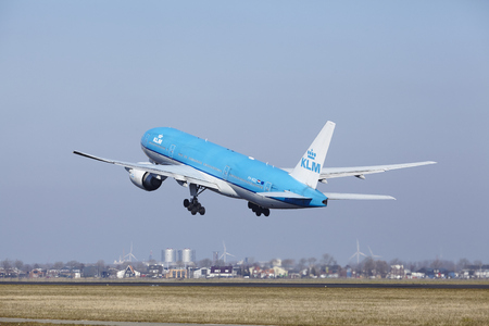 polderbaan: The KLM Boeing 777-206(ER) with identification PH-BQE takes off at Amsterdam Airport Schiphol (The Netherlands, AMS), Polderbaan on March 13, 2016.